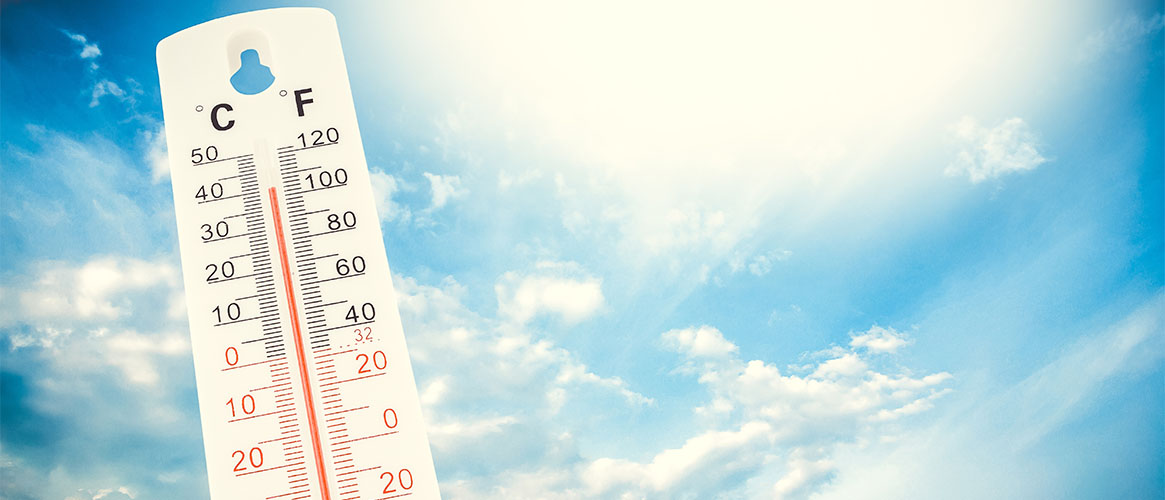 A thermometer in a blue sky background