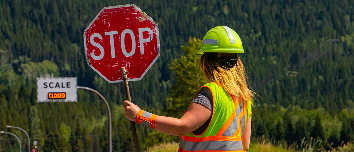flagger with stop sign