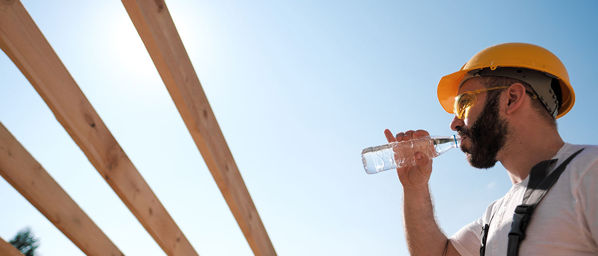 worker drinking water in the hot sun